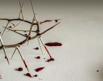 Crown of thorns with blood on canvas symbolic image. Crown of thorns with blood on canvas symbolic of Jesus Christ`s suffering on the cross Royalty Free Stock Image