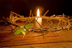 Crown of thorns and candle Royalty Free Stock Image