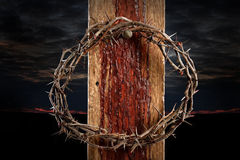 Crown of Thorns on Cross. Crown of thorns cross held by nail Stock Photo