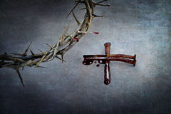 Crown of Thorns and Cross of Nails. Crown of thorns and cross of naiils with blood puddled on ends Royalty Free Stock Photo