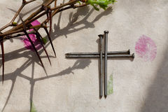 Crown of Thorns and crucifix. On   paper background Stock Photography