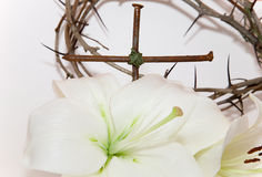Crown of Thorns, crucifix and white Lily. On  white background Stock Photo