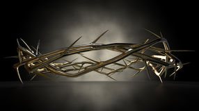 Crown Of Thorns Gold Casting. An upper view of a gold casting sculpture of branches of thorns woven into a crown depicting the crucifixion royalty free stock photo