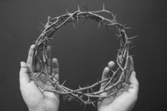 A crown of thorns on hands easter background stock image