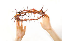 Crown of thorns and hands isolated Royalty Free Stock Images