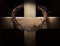 Crown of thorns and wooden cross stock image