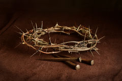 Crown of Thorns and Nails on Cloth Stock Photos