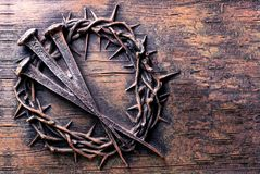 Crown of thorns and nails engraved on stone. Useful as Easter background Stock Photography
