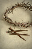 Crown of Thorns and Nails. Over vintage cloth Royalty Free Stock Images