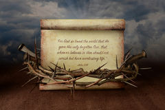Crown of Thorns Nails and Scripture. John 3:16 scroll surrounded by crown of thorns and nails Royalty Free Stock Photos