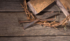 Crown of Thorns and Nails. On a wood surface Royalty Free Stock Photography