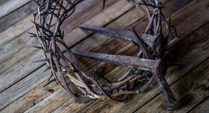 The crown of thorns and nails. The crown of thorns and the nails on wooden background Easter concept Royalty Free Stock Photo