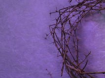 Crown of thorns on purple background. Half crown of thorns on purple background with negative space on the left side stock photo