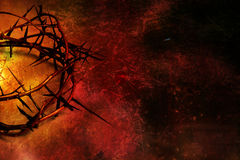 Crown of thorns on red and gold grunge background. A crown of thorns on a gold and dark red grunge background Stock Image