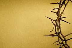 Crown Of Thorns Represents Jesus Crucifixion on Go. This Crown of Thorns against parchment paper represents Jesuss Crucifixion on the Cross, dying and then Stock Photography
