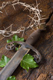Crown of thorns and sword Stock Photos