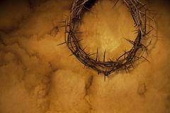 Crown of thorns on a textured background. Crown of thorns with shadow on top side of a textured background stock photos