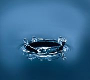 Crown water splash Stock Images