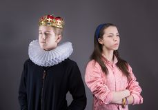 Crowned boy ignores the girl. Difficult teenager comminication concept Royalty Free Stock Image