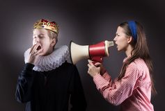 Crowned boy ignores the girl. Stock Image