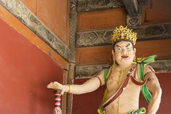 Crowned Buddha Statue with Green and Red Sash Royalty Free Stock Images