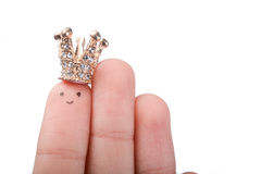 Crowned index finger. Finger with dots like a face and a crown on the top Stock Photography