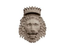 Crowned Lion. Bas-relief of a crowned lion made of stone Royalty Free Stock Image