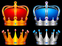 Crowns. Golden and silver crowns decorated with jewels Royalty Free Stock Images