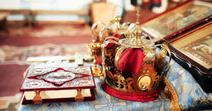 Crowns in the church. Crowns, Bible, icons and other objects in the church Royalty Free Stock Photos