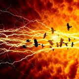 Crows in dark sky. Flock of flying ravens, crows in dark sky, bright lightning, end of world Royalty Free Stock Photo