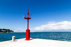 Crows Nest in Poreč, Croatia. Bright red crows nest on the coast in small Croatian town of Poreč with blue skies and turquoise sea as a backdrop to complete royalty free stock images
