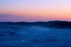 Crépuscule de prairie Photos libres de droits