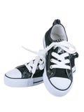 Cru arrêtant les chaussures noires Photographie stock