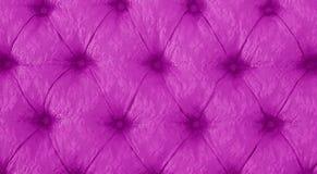 Cru Sofa Button pourpre pour le fond texturisé photographie stock libre de droits
