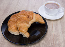 Cruasán y café Imagen de archivo