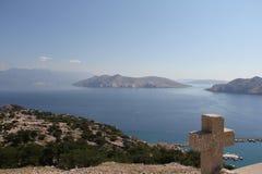 Cruce encima el paisaje del mar Foto de archivo
