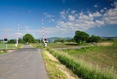 Cruce ferroviario rural imagenes de archivo