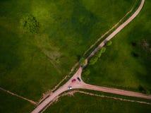 Cruce y tierras de labrantío Imagenes de archivo