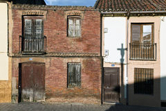 Cruceiro shadow reflection in the wall. View of typical houses of northern Spain with a shadow reflection of a cruceiro Stock Images