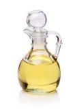 Cruche avec le pétrole sur le blanc Photos stock