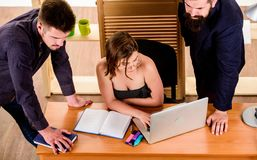Crucial discussion. Professional people participating in business discussion. Discussion group working and communicating. At office desk together with royalty free stock photography