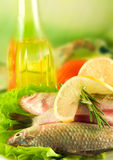 Crucian with a lemon and an onions, salad Stock Photo