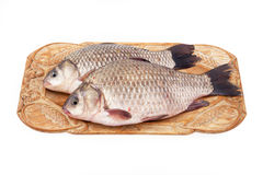 Crucian on a plate Royalty Free Stock Photos
