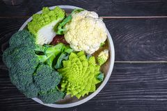 Cruciferous Vegetables. Romanesco, Cauliflower And Broccoli On A Round Tray On A Wooden Background. Flat Lay. Top View Royalty Free Stock Photography