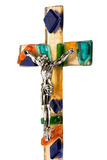 Crucified Christ on a colorful glass cross Royalty Free Stock Photo