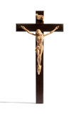 Crucified Christ on a cross over white. Crucified figure of Christ on a plain cross isolated over white conceptual of the crucifixion, forgiveness, resurrection stock image