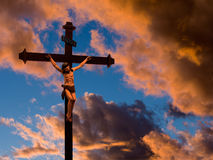 Crucified Christ over red evening sky Royalty Free Stock Images