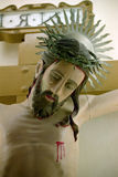 Crucified Jesus Christ. Close up of the crucified Jesus Christ in a Roman Catholic Church in Macau Stock Photos