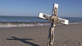 Crucified Jesus Christ on a metal cross on the beach stock video footage