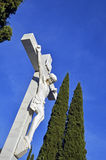 Crucified sculpture in the cemetery Stock Photos